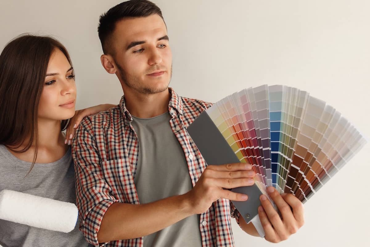 Choice of color for painting wall. Couple with color palette. Copy space