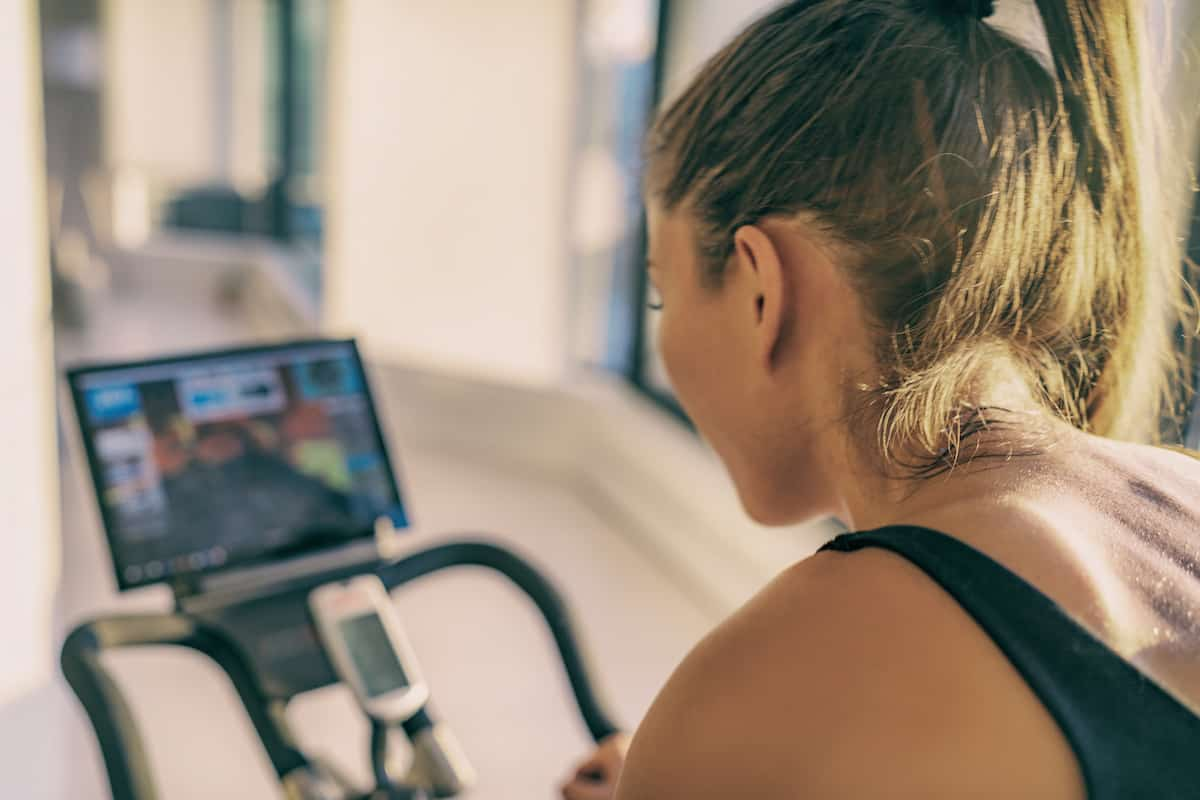 Woman riding bike in home gym